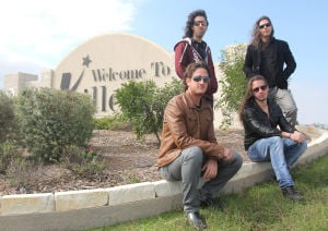 Seek Irony: Daniel Strosberg, Alex Campbell, front, and Rom Gov and Kfir Gov, back row, members of the band Seek Irony, are seen Tuesday, Nov. 12, 2013, at the Welcome to Killeen sign. The modern rock group is originally from Israel and recently relocated to Austin. - Photo by Herald/CATRINA RAWSON