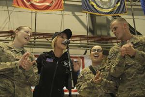 "<p>Soldiers from Bagram Airfield in Afghanistan were invited onto the stage by country music singer Kellie Pickler to sing her hit ""Red High Heels"" during a USO tour show Dec. 9.</p>"