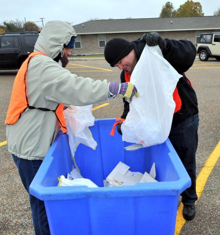 Cove residents combat identity theft on during free Shred-It Day