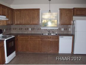 Spacious open floor plan, carpet through out, tiled kitchen