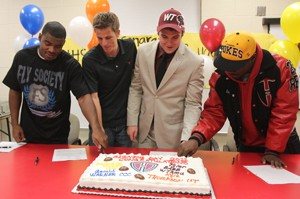 Heights athletes sign with colleges