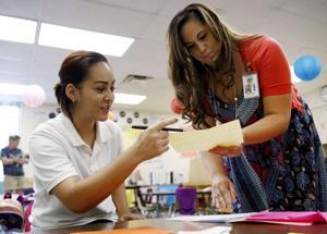 Photo: Parents meet teachers before school year begins