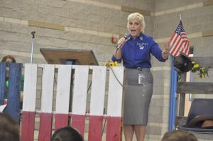 <p>Copperas Cove Independent School District Child Nutrition Director Melissa Bryan encourages students to vote for their favorite Texas produce during the Best Vegetable Subgroup Election Debate as part of National School Lunch Week.</p>