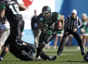 Brandin Byrd North Texas: North Texas running back Brandin Byrd (24) carries the ball as tight end Marcus Smith (18) blocks against UNLV during the second half of the Heart of Dallas Bowl Wednesday in Dallas. - Photo by Mike Stone | AP