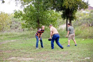 Woods Family: Jacob Woods faces off with is dad Bryan during a game of football, while brother Mathew waits for a pass.