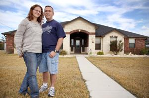 <p>Clyde and Sharon Hippensteel are photographed outside of their new home Monday afternoon in Kempner, Texas. (Eric J. Shelton | Herald)</p>