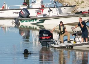 Belton Lake Search: A member of the Morgan's Point Resort dive team begins searching for Joshua Joe Barnes, 38, of Gatesville, after Barnes jumped into Belton Lake on Wednesday, Oct. 23, 2013, following a police chase. - Deborah McKeon | FME News Service