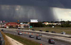 <p>Storm clouds dump rain on U.S. Highway 190 in Killeen on Wednesday afternoon.</p>