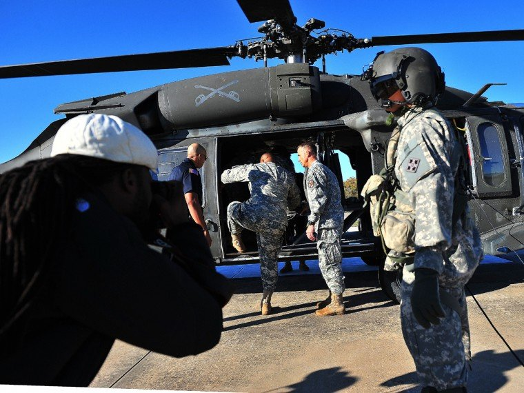 Sgt major Arthor Coleman climbs into blackhawk