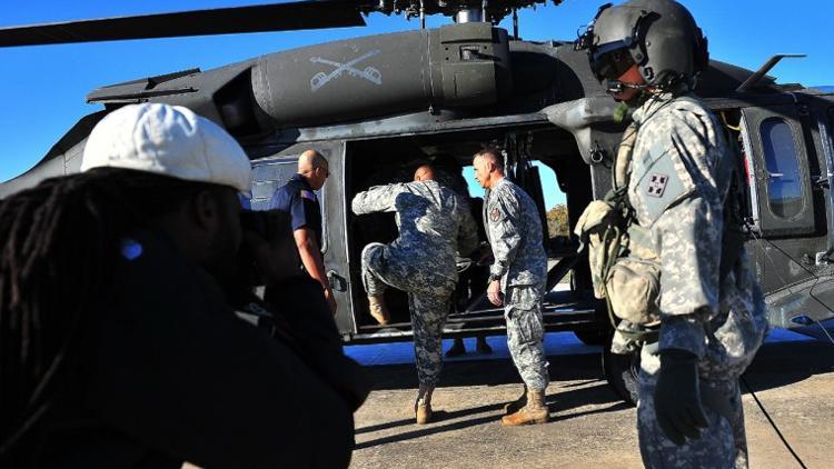 Sgt major Arthor Coleman climbs into blackhawk