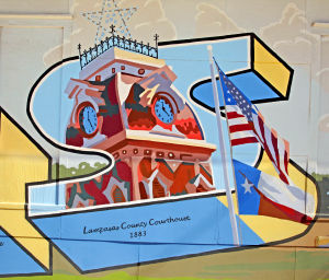 "Lampasas Murals: The ""Postcard from Lampasas"" was inspired by ""big-letter"" souvenir postcards. The letters contain pictures of historical landmarks that can still be found in present day Lampasas. - Jaime Villanueva 