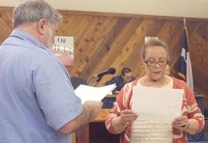 <p>Nolanville Mayor Dennis Biggs swears in newly appointed Councilwoman Aurelia Ridley on Thursday night.</p>