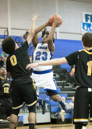 <p>Lampasas' Jason Murphy (23) drives to the basket between Gatesville defenders on Tuesday night in Lampasas. Murphy finished with 15 points and seven rebounds in the Badgers' 63-34 victory.</p>