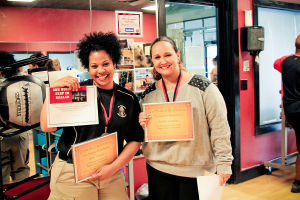 Biggest Loser (7): Diane Thomas (left) and Kristen Carmona (right) show off their awards for winning first place in their participation in the Biggest Loser competition at Heritage Park Fitness on March 10th. - Jodi Perry/HERALD
