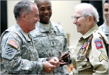 World War II veteran Bob Bearden presented with medals, badges