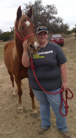 <p>Rachel Loscomb stands with 4-year-old gelding RGD Liberty Sun. Loscomb is a volunteer with STAR Healing with Horses and a student at Texas A&M University-Central Texas. She is studying for a master's degree and is an equine assisted therapist who lives in Killeen.</p>