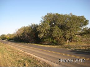 Very nice 2 acres with large trees, within 1 mile