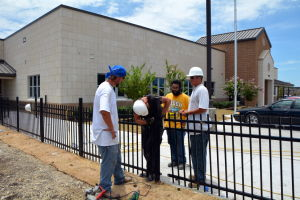 Crews install fences at Fowler elementary