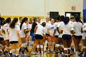 <p>Copperas Cove volleyball coach Cari Lowery, center in blue shorts, gives instructions to players during Monday's tryout.</p>
