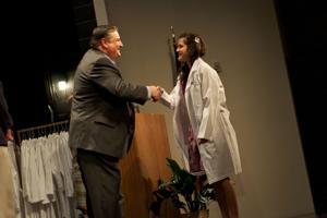 17 Heights High students receive TBI lab coats