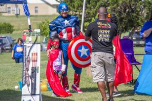 Superheroes swarm Fun Day in the Park for kids of all ages