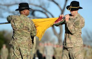 <p>Command Sgt. Maj. Brian Barker, right, and Col. Kevin Admiral of the 3rd Cavalry Regiment uncase the colors at Cooper Field as approximately 200 soldiers return to Fort Hood after a nine month deployment to Afghanistan on Thursday, Feb. 16, 2017.</p>