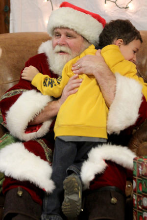 Copperas Cove Boy Scout Christmas Party: Caden Smith, 4, gives a hug to Santa while taking part in the annual Boy Scouts of Leon Valley District Christmas party, Wednesday, December 18, 2013 at Copperas Cove Veterans of Foreign Wars Building. - Photo by Herald/CATRINA RAWSON