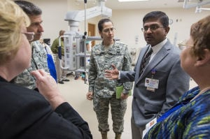 New VA Cath Lab: Dr. Rajiv Gupta, second from right, provides a tour for interested parties, including Col. Patricia Darnauer, center, of the new heart catheterization lab at the Temple VA on Thursday, Nov. 7, 2013. - Photo by Michael Miller | FME News Service