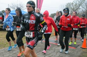 Tough Cookie Duathlon: Braving cold temps and rain, women run the 5k portion of the Tough Cookie Duathlon in Copperas Cove on Sunday, March 2, 2104. - Bryan Correira | Herald
