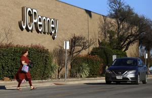 <p>A customer walks out of JC Penney Friday at the Killeen Mall. J.C. Penney plans to close 130 to 140 stores, but the status of the local location is unclear.</p>