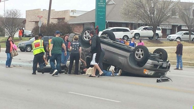 Vehicle flips multiple times in Heights