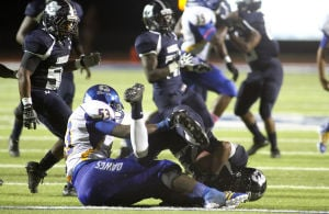 Football: Copperas Cove V. Shoemaker: Copperas Cove's Tyrell Thompson takes down Shoemaker's Rayshun Spearman after Spearman couldn't corral a high snap during a punt attempt Friday night at Bulldawg Stadium. Copperas Cove scored a touchdown on the next play. - Photo by Herald/MARIANNE LIJEWSKI