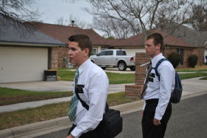 Mormon: Mormon missionaries Granden Ray, left, and Skylar Warden walk in the neighborhood outside their church. Both out-of-towners, they will see if they will stay in the Copperas Cove area to continue their work Wednesday. - Courtney Griffin | Herald staff writer