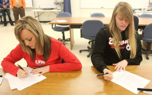 Copperas Cove National Signing Day: Cooperas Cove senior Shelbie Letzer, left, signs with Incarnate Word University and Lauren Heck signs with Bacone College during National Signing day Wednesday, February 5, 2014 at Copperas Cove High School. - Herald/CATRINA RAWSON