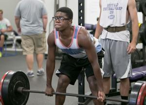 <p>Florence's Edel Hernandez works out in the weight room at Florence High School.</p>