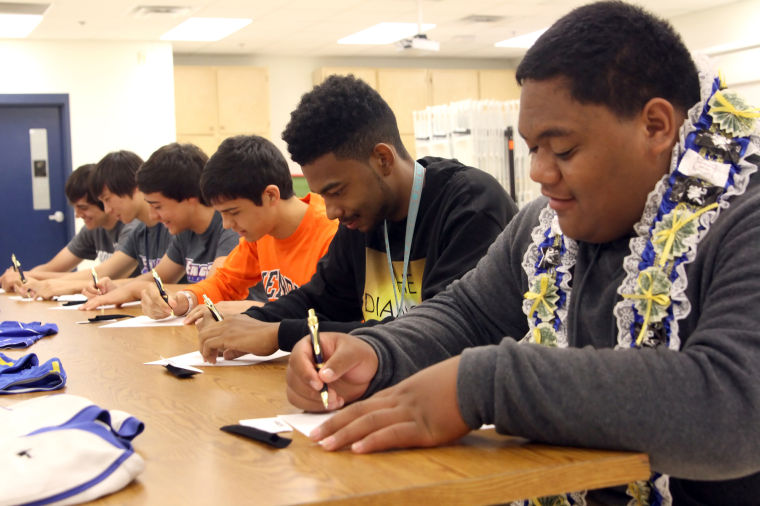 Six Cove players sign with colleges