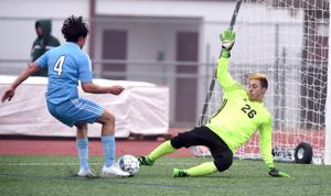 <p>Copperas Cove goalkeeper Noah Quinn comes off his line to challenge China Spring's Griffin Kenneaster on Saturday at Leo Buckley Stadium during the Harker Heights Winter Showcase. Cove scored a late goal and won 3-2.</p>