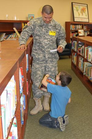 Soldiers reading to kids