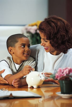 Mother teaching son about money