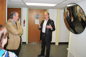 Mental Health Facility: A security mirror at the mental health crisis respite center in Gatesville reflects a conversation between Allen Place, right, Dewey Jones and a member of the center staff during a tour of the center Jan. 16. A second mental health center is proposed for Copperas Cove. - Tim Orwig | Herald