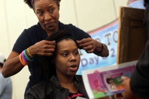 Natural Hair.Photo J.Villanueva 0001.jpg: Marilyn Wade, owner of The Natural Me, styles Renee Thomas' hair during Saturday's Armed Forces Natural Hair and Health Expo at the Killeen Civic and Conference Center. - Jaime Villanueva