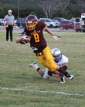 <p>Kyle Molter carries for Lometa last week against Richland Springs.</p>
