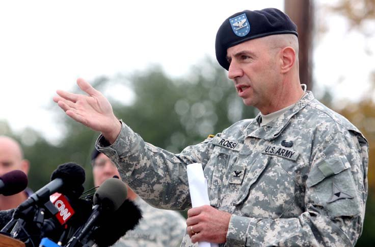 Col. John Rossi speaks during press conference