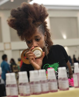 Natural Hair.Photo J.Villanueva 0002.jpg: Paulette Anderson smells soap during the third Armed Forces Natural Hair and Health Expo Saturday afternoon at the Killeen Civic and Conference Center. - Jaime Villanueva