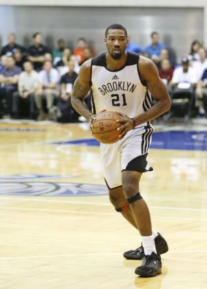 <p>Brooklyn Nets forward Cory Jefferson moves the ball against the Oklahoma City Thunder during an NBA Summer League game in Orlando, Fla., on July 7.</p>