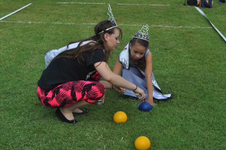 Rabbit Fest royalty assist at bocce ball contest
