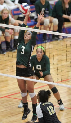Ellison Vs Mansfield Volleyball: Ellison's Asia Howard goes up for a block against Mansfield in their Class 5A bi-district playoff match Tuesday at Midway High School in Waco. - Herald/CATRINA RAWSON
