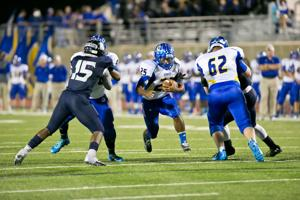 <p>Cove Remington Weis (62) and Kehoness James (46) pave the way for Trent Canion.</p>