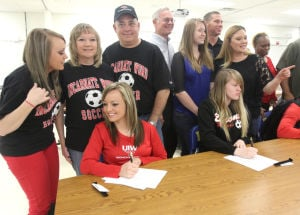 Copperas Cove National Signing Day: Cooperas Cove seniors Shelbie Letzer signs with Incarnate Word University and Lauren Heck signs with Bacone College during National Signing day Wednesday, February 5, 2014 at Copperas Cove High School. - Herald/CATRINA RAWSON