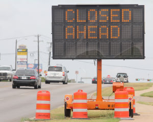 FM 2410 Construction: A road sign cautions drivers as construction efforts continue on the Farm-to-Market 2410 bridge Monday in Harker Heights. The TxDOT construction project, which started Aug. 19, will add a left-turn-only lane, according to Mark Hyde, the city's public works director. - Herald/CATRINA RAWSON